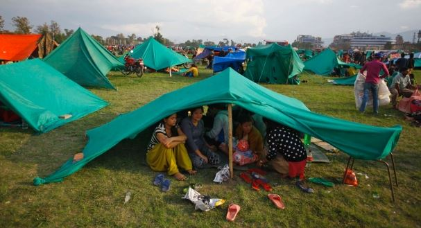 Family living in a tent in Nepal after the earthquake; Photo from Yahoo Photos