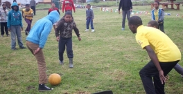CYCWs play soccer with children at the Safe Park