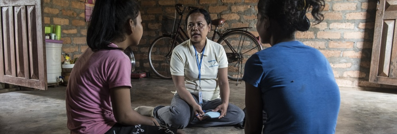 social worker meeting with a family with Cambodia