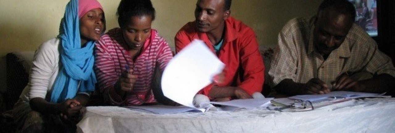 A group reviews documents in Ethiopia