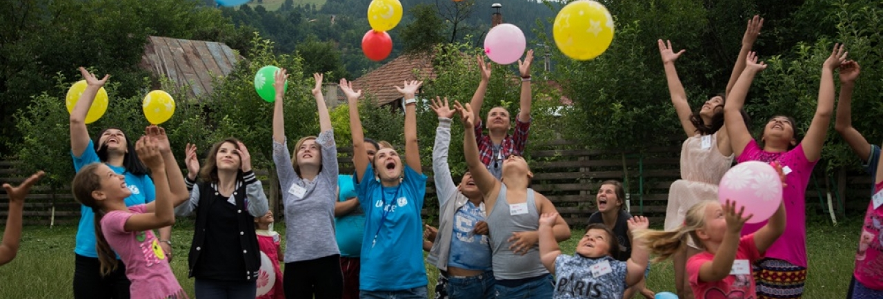 Children release balloons at a children's centre in Romania