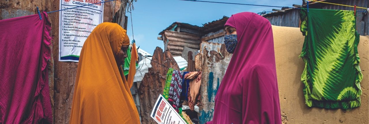 A social worker speaks with a women in Somalia.