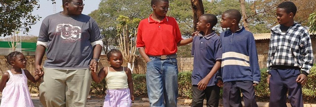 Children walking together, holding hands