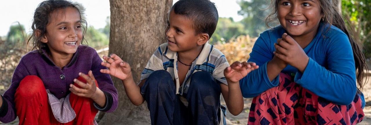 Three children smiling in India